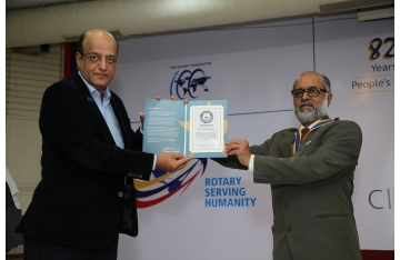 Receiving Guinness world record for blood donation